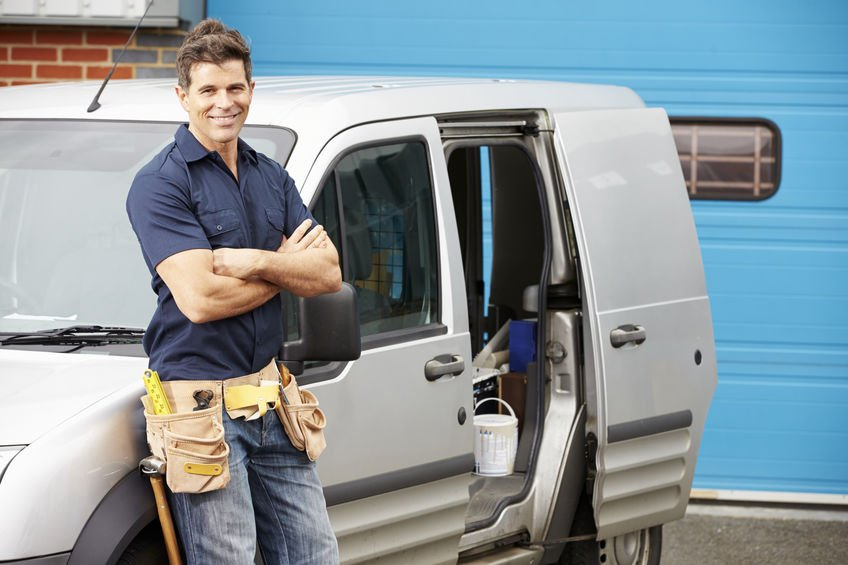 mesa plumber standing next to van