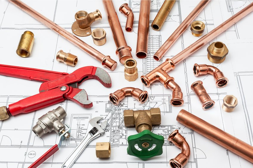An image of plumbing remodeling plans and tools in Tempe.