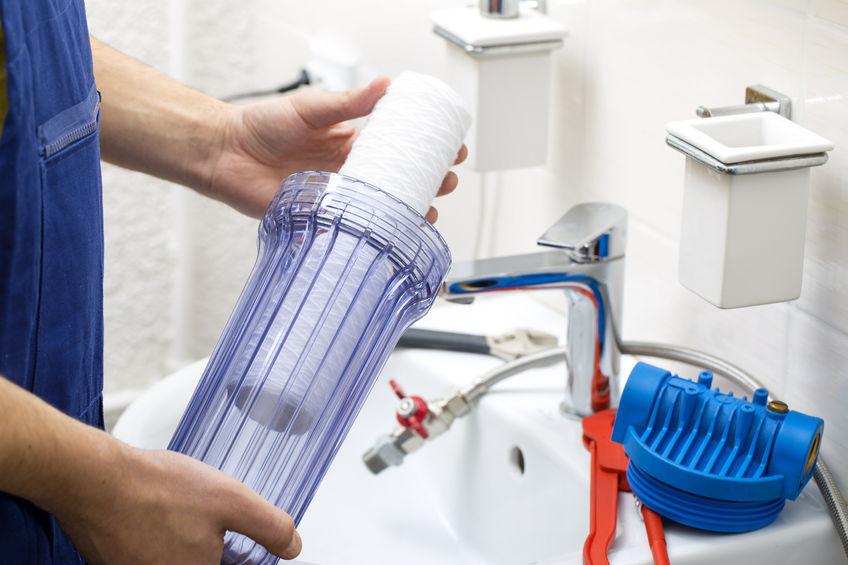 plumber installing water filtration system in mesa az